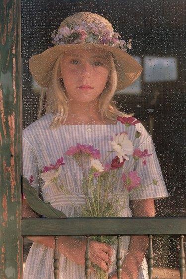 Portrait of girl through screen door