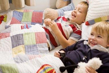 Boys lying in bed