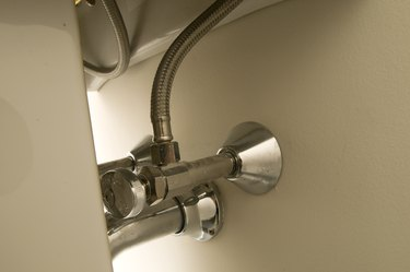 Pipes and valves underneath sink