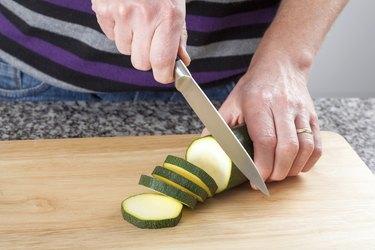 Man cutting a zucchini