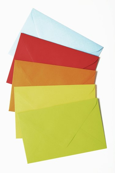 Five multi-colored envelopes.