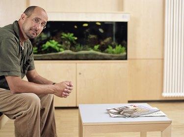 Mature man sitting in waiting room, portrait