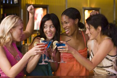 Women toasting cocktails