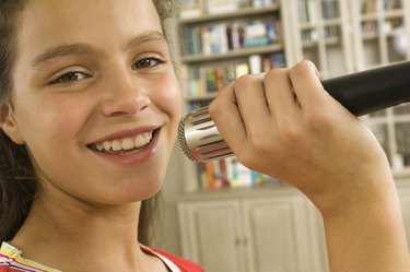Girl singing into microphone