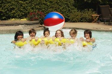 Teenagers in swimming pool