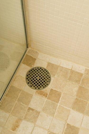 Drain in shower on tile floor