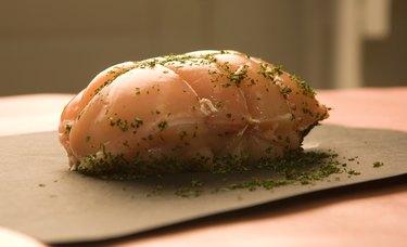 Uncooked roast on counter with seasonings