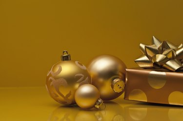 Christmas gifts wrapped in silver and gold paper