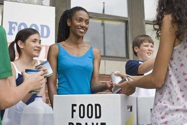 People volunteering at food drive