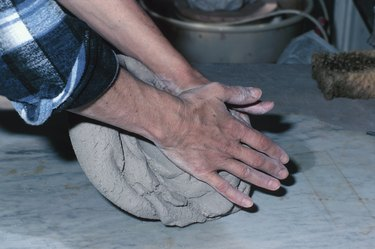 Person kneading clay