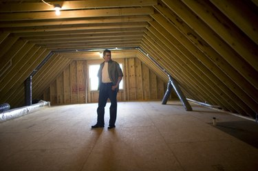 Man in empty attic