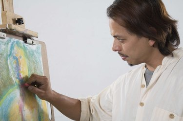 Man drawing with pastels
