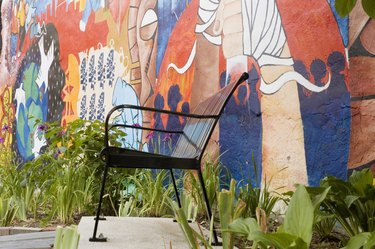 Close-up of chair in front of a painted wall, Washington DC, USA