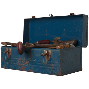 Rusty tool in blue metal box L2