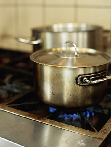 saucepan on a burner in the kitchen