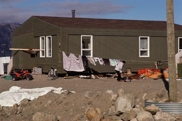 Woman doing laundry outside trailer home
