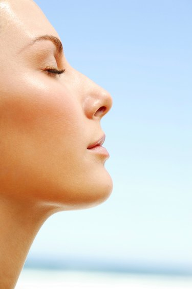 Profile of woman basking in the day