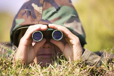 Soldier using binoculars