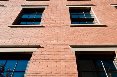 Low angle viw of brick building with windows