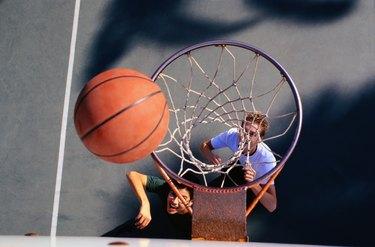 Two Teenage Boys Playing Basketball