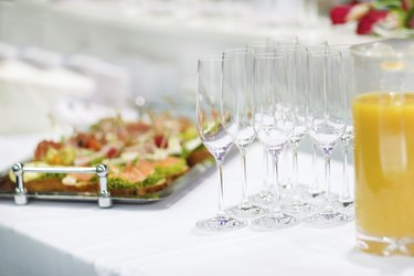 Empty champagne glasses and finger food on festive wedding table
