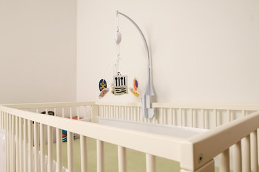 Crib and mobile in nursery