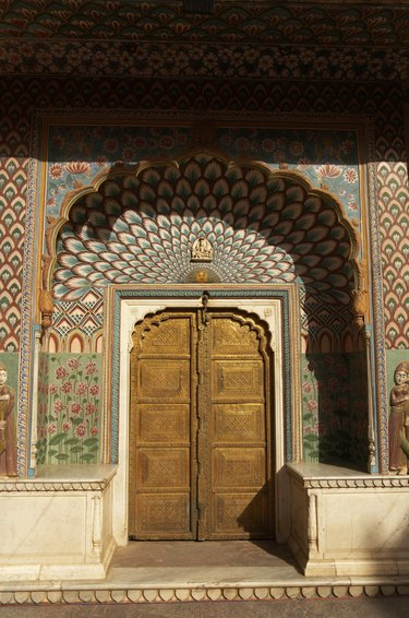 India, Jaipur, City Palace, Peacock Gate decorated arch door surround