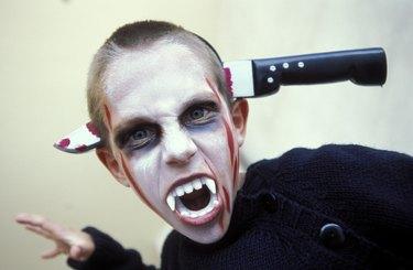 Boy dressed as vampire for Halloween