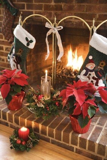 Christmas stockings over fireplace