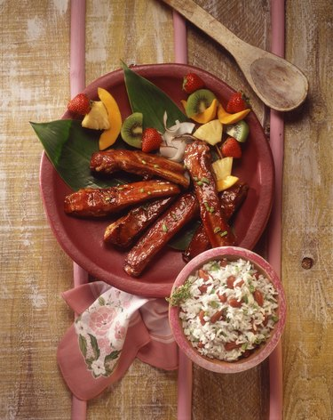 BBQ ribs with fruit kabobs and rice