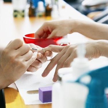 Salon Worker Applying Nail Polish