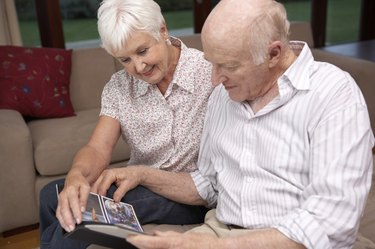 Couple looking at photo album together