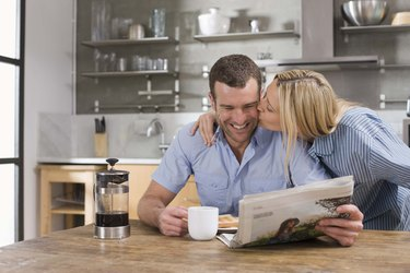 Couple at kitchen table for breakfast