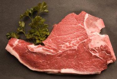 High angle view of raw pork chop