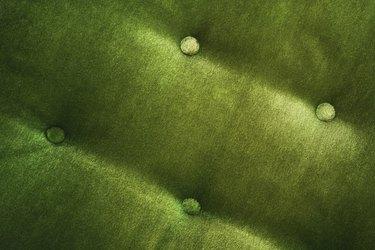 Detail of green velvet chair