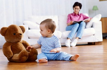 Infant Playing with a Teddy Bear