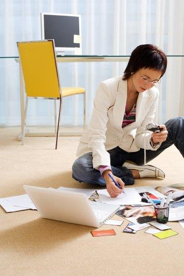 Businesswoman sitting on the floor to work