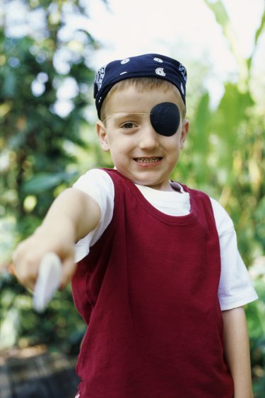 Portrait of a boy pretending to be a pirate