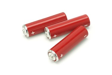 Three red AA size batteries