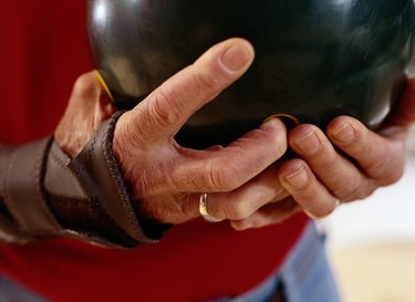Close-Up of a Man Holding a Bowling Ball