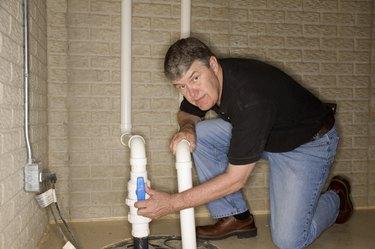 Man checking pipes