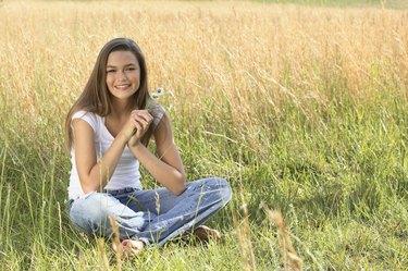Portrait of girl sitting in grass