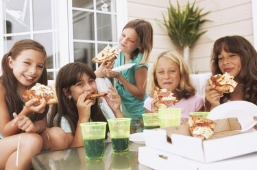 Girls having a pizza party