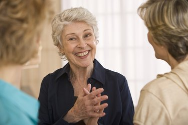 Mature woman talking with friends