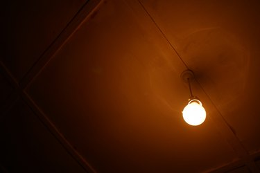 Glowing light bulb in darkness