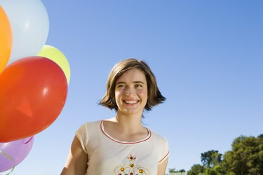 Teen girl with balloons