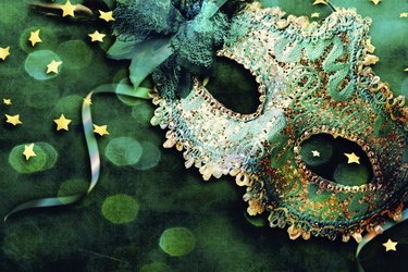 Female carnival mask with shiny background.