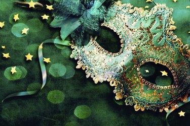 Female carnival mask with shiny background.