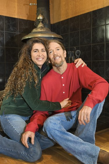 Couple sitting by wood stove
