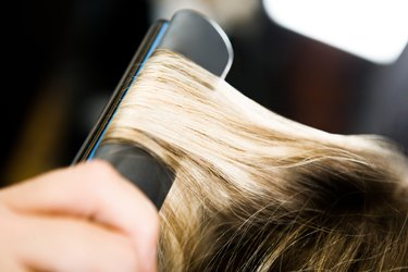 Client having hair straightened